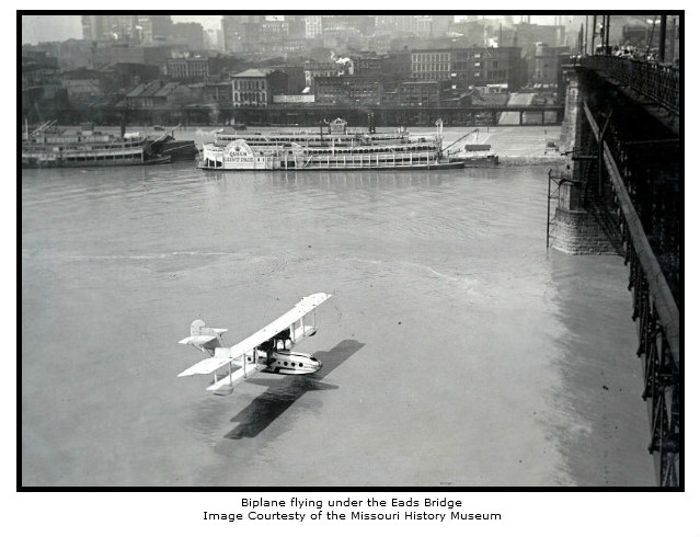 Biplane Flying Under Eads Bridge